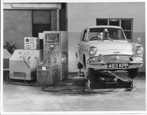 Peter Challis's Ford Anglia 105E (Pompadour Blue, white wall tyres) on Mike Wilkey's R&I vibration platform, 1962